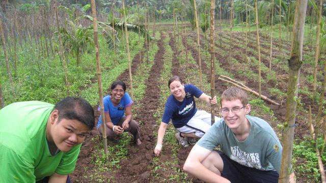 Sister missionaries working the fields in the Phillipines